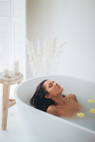 woman-lying-in-bathtub-with-water-3865761